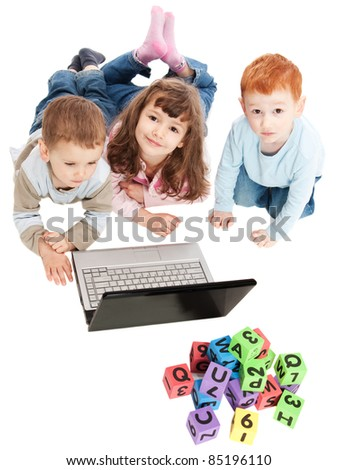 Children learning with computer and alphabet blocks. Isolated on white - stock photo