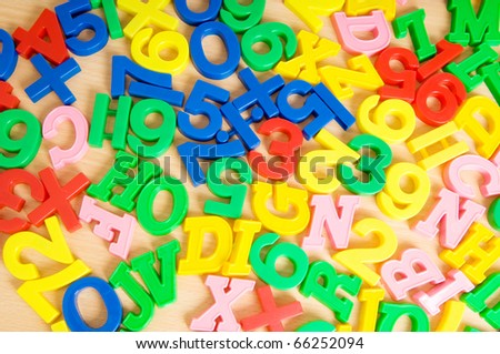 Children letters and digits on the table - stock photo