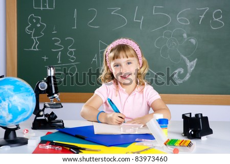 children little girl at school classroom with microscope in science class - stock photo