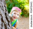 children little girl happy playing in forest tree with party makeup - stock photo