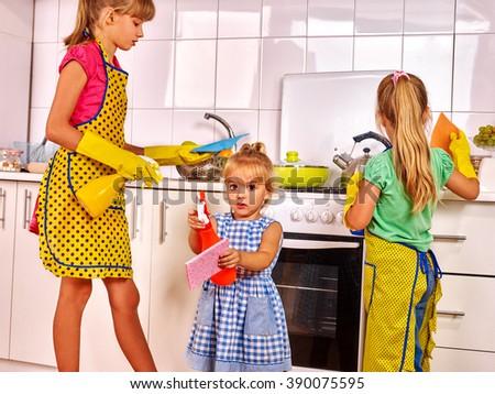 Children little girl wash kitchen at kitchen. Kitchen cleaners. - stock photo
