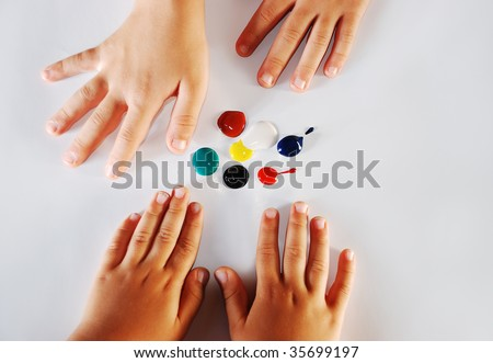 Children little hands playing with colors on white background