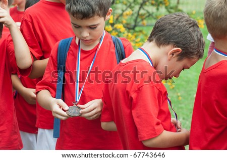 children looked medals - stock photo