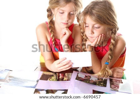 children looking at photos together - stock photo
