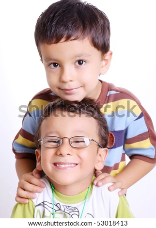children looking at the camera smiling over white background