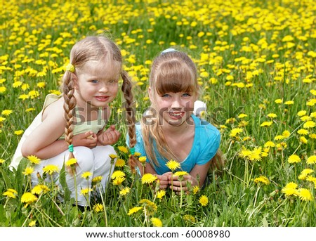 Children lying in field with flower. Outdoor.