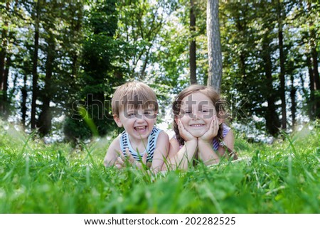children lying on high grass