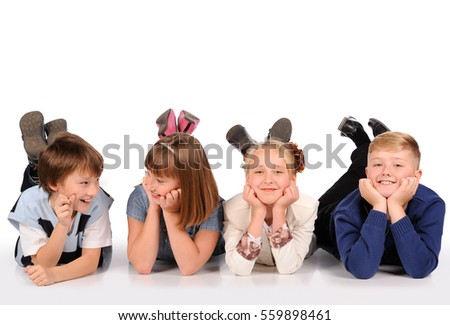 children lying on the floor isolated over white background