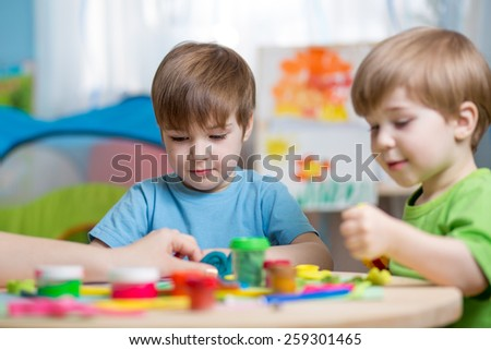 children making by hands with play clay - stock photo