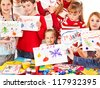 Children making greeting card. Isolated on white. - stock photo