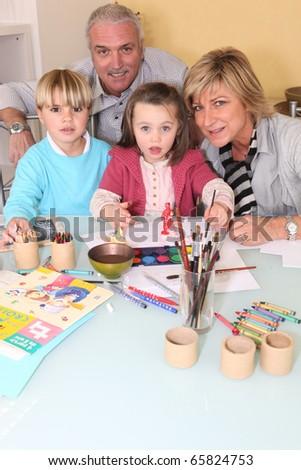 Children making watercolors with children - stock photo