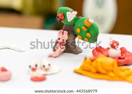 Children molding plasticine play - stock photo