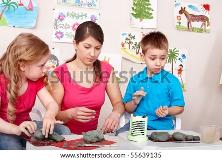 Children mould with teacher from clay. Child development. - stock photo