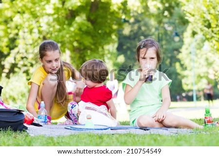 Children on a picnic - stock photo