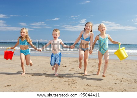 Children on beach vacation - stock photo