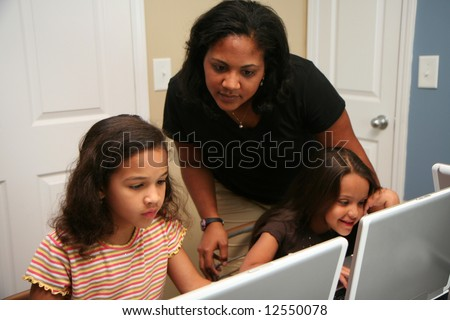 Children on computers at school - stock photo