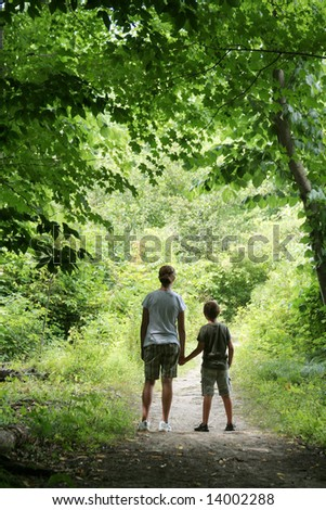 CHILDREN ON NATURE HIKE - stock photo