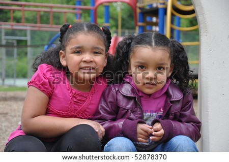 Children on Playground with family - stock photo