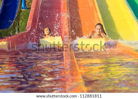 Children on the water slide - stock photo