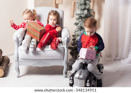 Children opening presents - stock photo