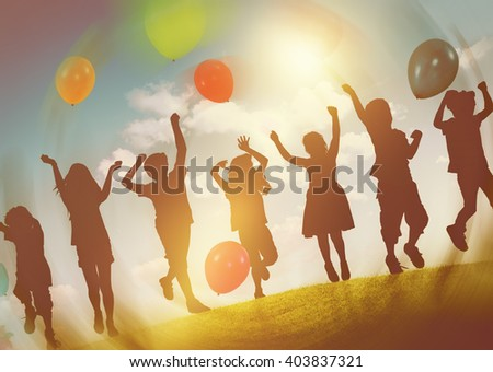 Children Outdoors Playing Balloons Together Concept - stock photo