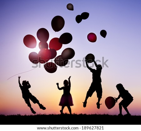 Children Outdoors Playing with Balloons - stock photo