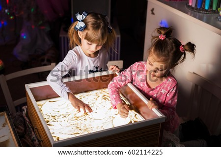 Children paint in the sand, sand animation