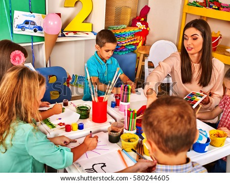 children painting and drawing in kids club craft lesson in primary school kindergarten teacher - Children Painting Images