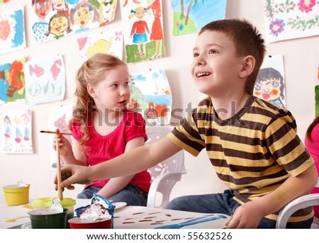 Children painting in art class. Child development. - stock photo