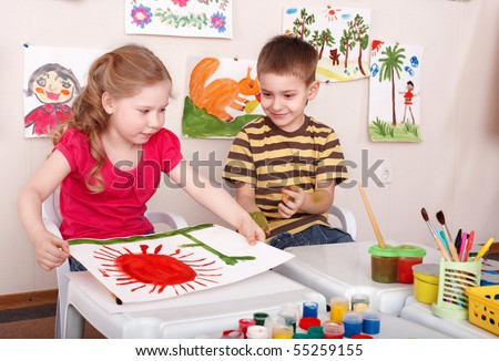 Children painting in play room. Child care. - stock photo