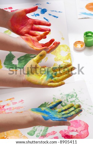 children painting with their hands - stock photo