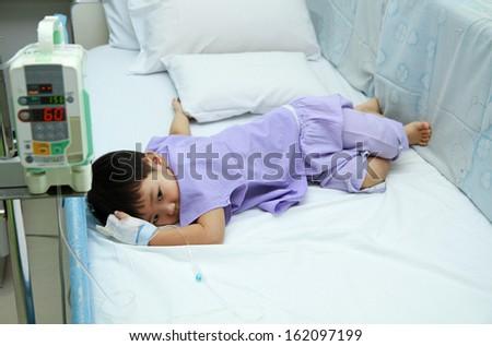 Children patient in hospital bed  - stock photo