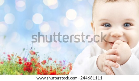 children, people, infancy and age concept - beautiful happy baby over blue lights and poppy field background - stock photo