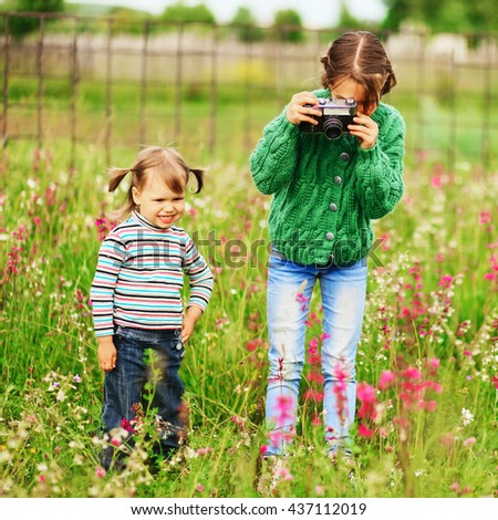 Children pictures of flowers on the meadow.