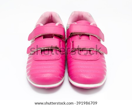 Children pink sport shoes isolated on a white background