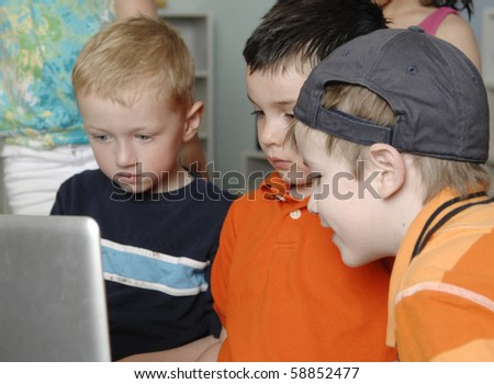 Children play and learn while using a laptop computer at the preschool class.