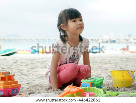 Children play in the sand at the beach.Family photo. Family photo for the background. Happy family.Young Asian model.