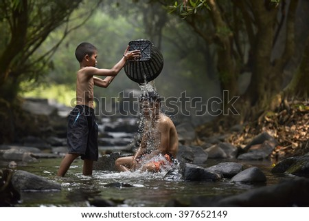 Children play in the water - stock photo
