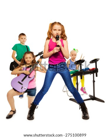 Children play musical instruments as rock group - stock photo