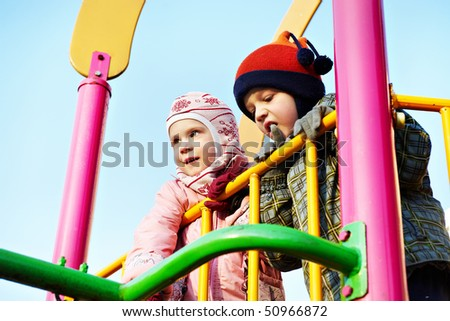 Children play on the playground for games in spring