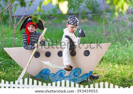 children play pirates at backyard - stock photo