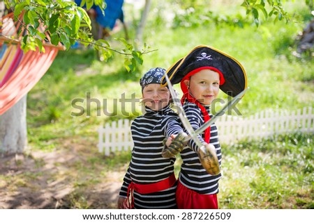 children play pirates outdoors - stock photo