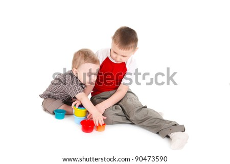 Children play with color toys. It is isolated, a white background