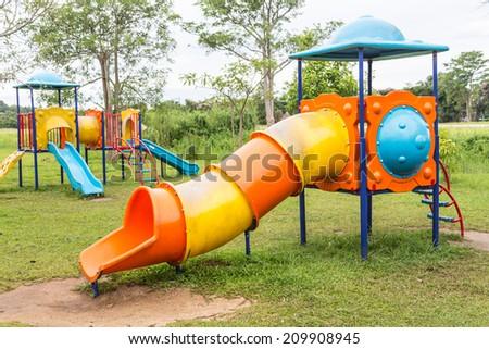 Children playground in park - stock photo