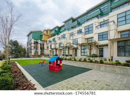 children playground in the inner yard of a condo - stock photo