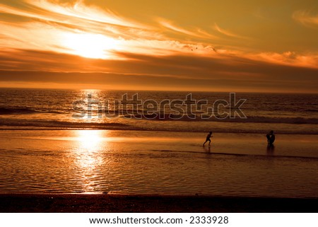 Children Playing at Beach at Sunset