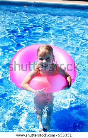 Children Playing at the Pool - stock photo
