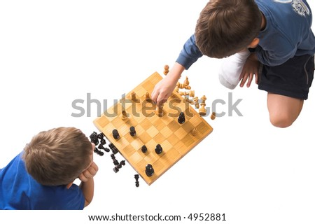 children playing chess with pieces in checkmate, isolated over white - stock photo