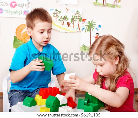 Children playing construction set . - stock photo