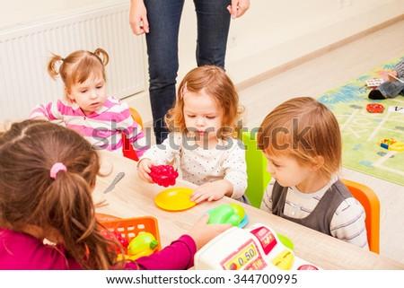 Children playing cooks - stock photo